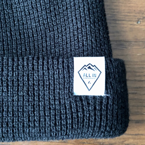 All In Cuffed Beanie - Black Logo by Vince Miller