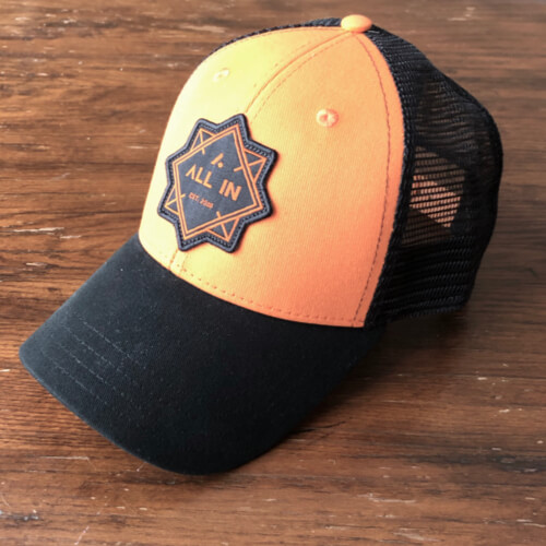 All In Trucker Mesh Hat - Front Angle Orange Top by Vince Miller